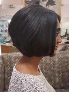 Dark hair bob female haircut by Megan side on.